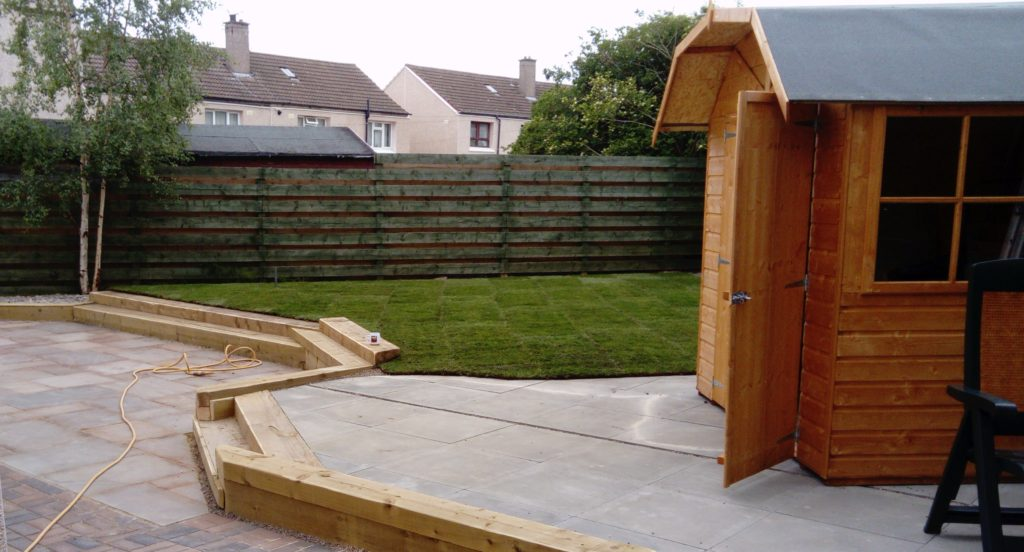 Sleeper Steps with a patio and lawn